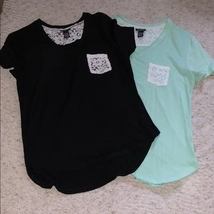 2 of the same tops black and mint green